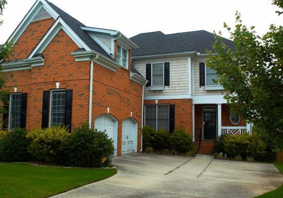brick house with painted trim