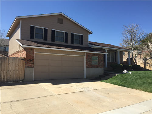 Exterior house painting by CertaPro painters in Wheat Ridge, CO