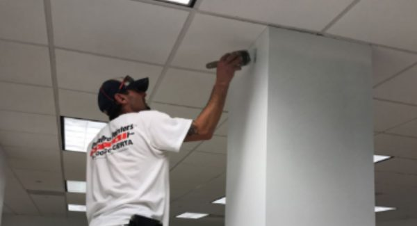 commercial painter working on interior project in atlanta
