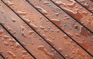 water on mahogany deck