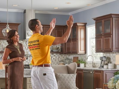 certapro painters employee talking with customer