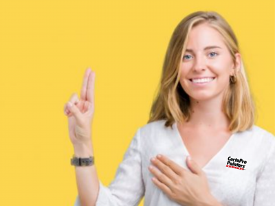 Blond woman holding up 2 fingers with gold background and CertaPro shirt on