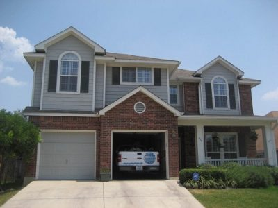 Exterior house painting by CertaPro painters in Stone Oak, TX