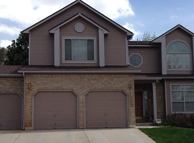 Exterior painting by CertaPro house painters in St. Andrews Country Club, CO