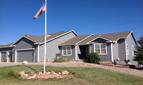 Exterior painting by CertaPro house painters in Peyton, CO