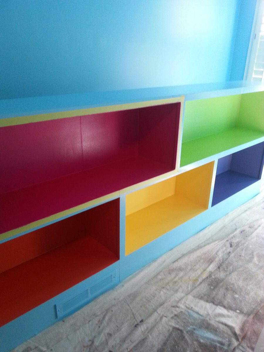 Multi colored bookshelves