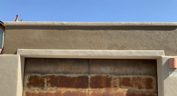 Stucco repaired on garage pop out