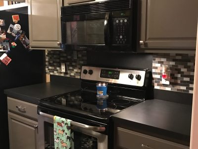 Interior kitchen painting by CertaPro painters in Fayetteville, AR