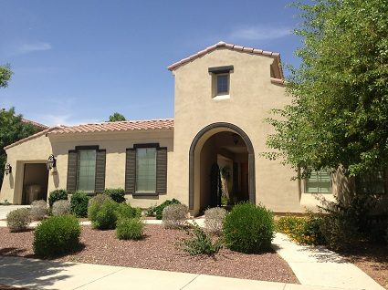 Exterior house painting by CertaPro painters in Buckeye, AZ
