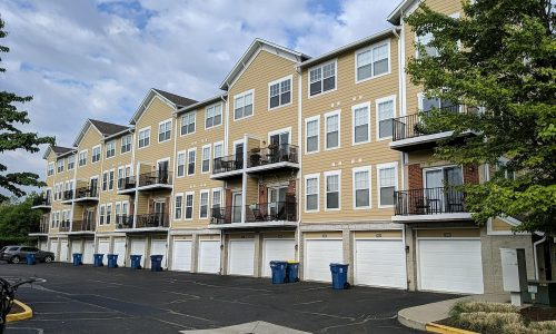 4 Story Townhome Painting Requiring Boom Lift Use with Trained Painters