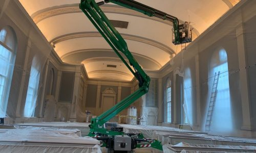Atrium Lift Being Used to Paint Sanctuary & Chapel Interiors