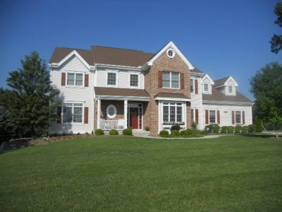Exterior painting by CertaPro house painters in Texas Township