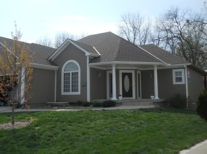 Exterior house painting by CertaPro painters in Lee's Summit, MO