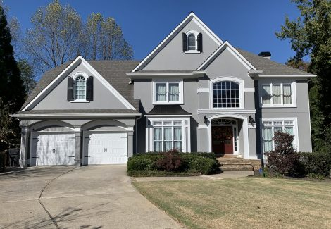 Exterior Painted Stucco Home with Double Garage