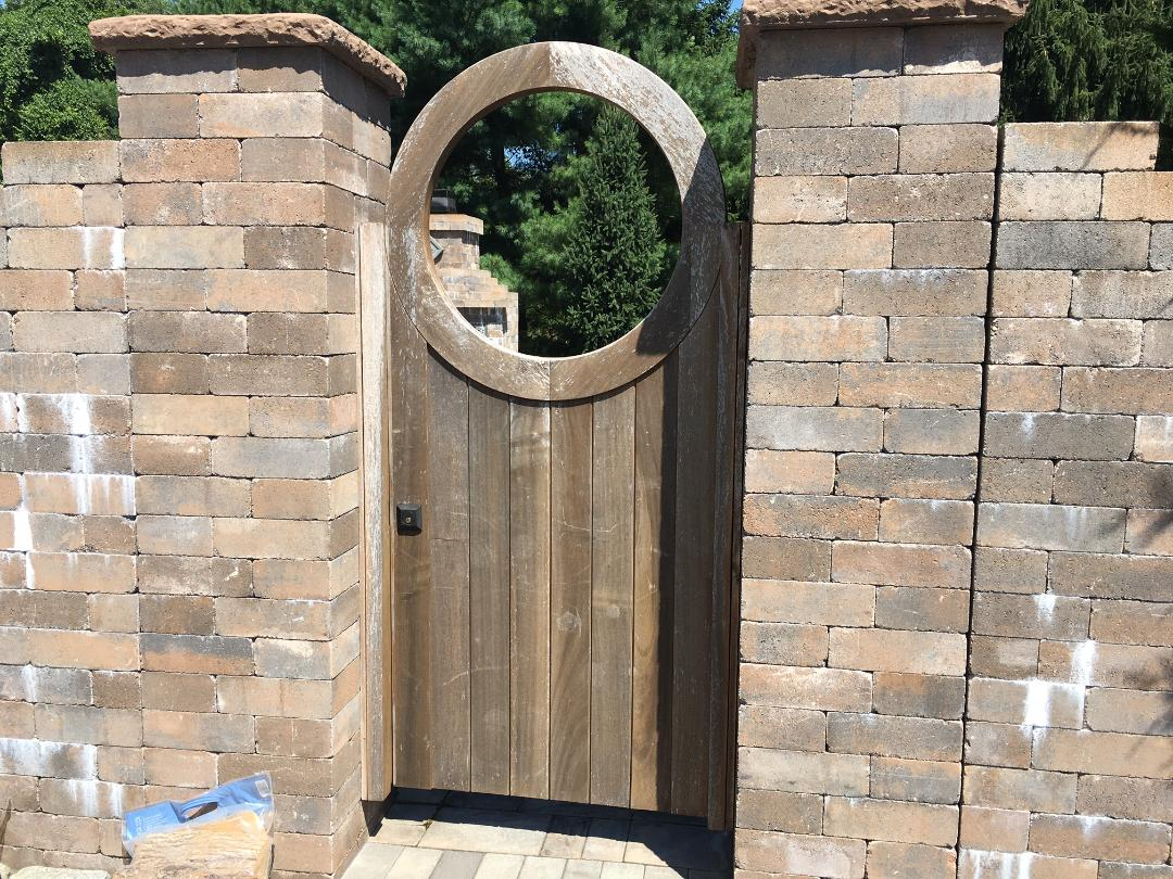 Exterior gate in natural wood finish Before