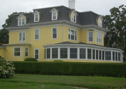 Classic Yellow Home with White Trim in Groton, CT