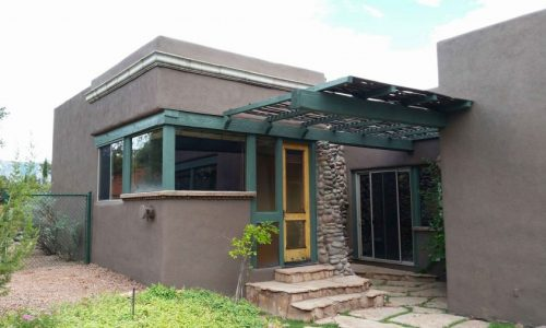 Brown Stucco & Green Features