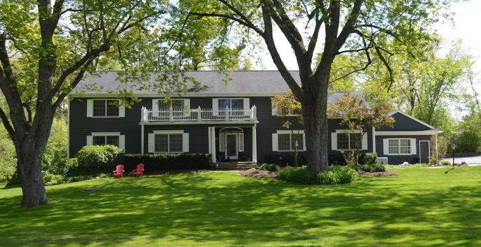 Exterior house painting by CertaPro painters in Franklin, MI