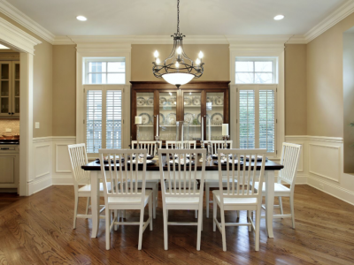 Residential painting in tan colored dining room