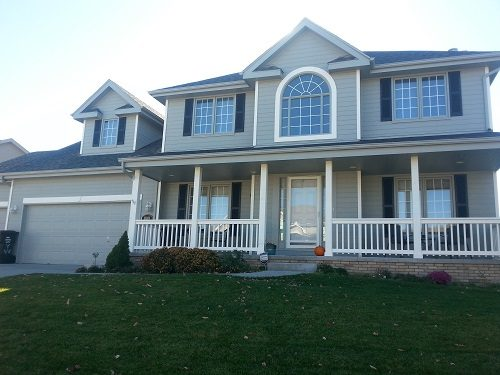 Exterior house painting by CertaPro painters in West Omaha, NE