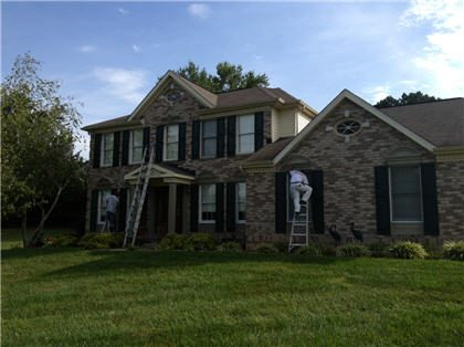 Exterior house painting by CertaPro painters in Woodstock