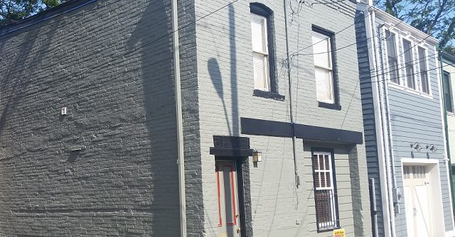 Two story brick after painting