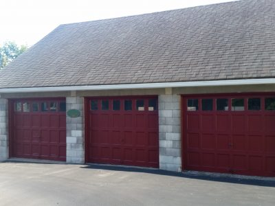 Exterior painting of a triple car garage