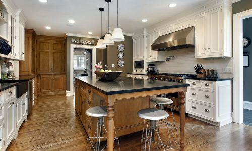 Kitchen with Island and White Cabinets