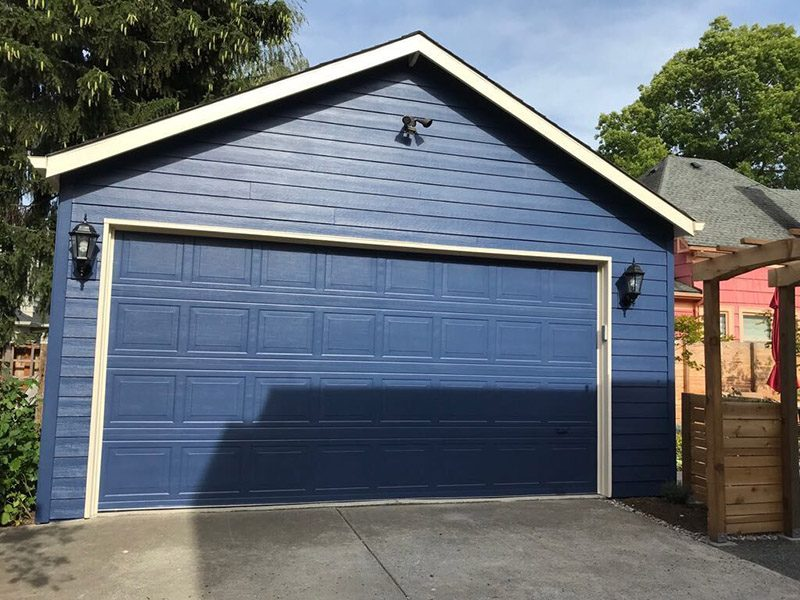 Exterior garage door painting by CertaPro house painters in Portland, OR