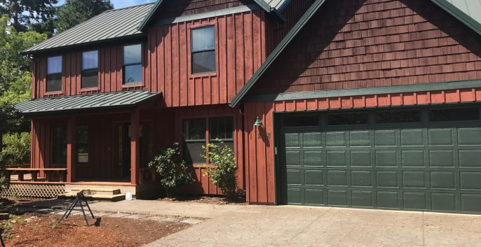 red wood home exterior painting
