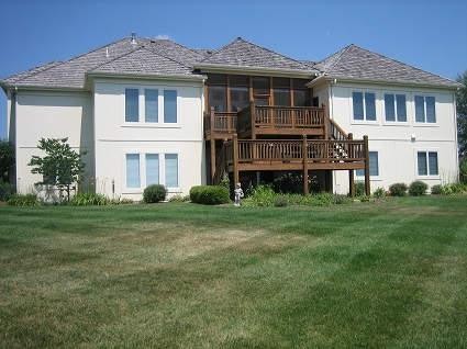 Exterior painting by CertaPro house painters in Lenexa, KS