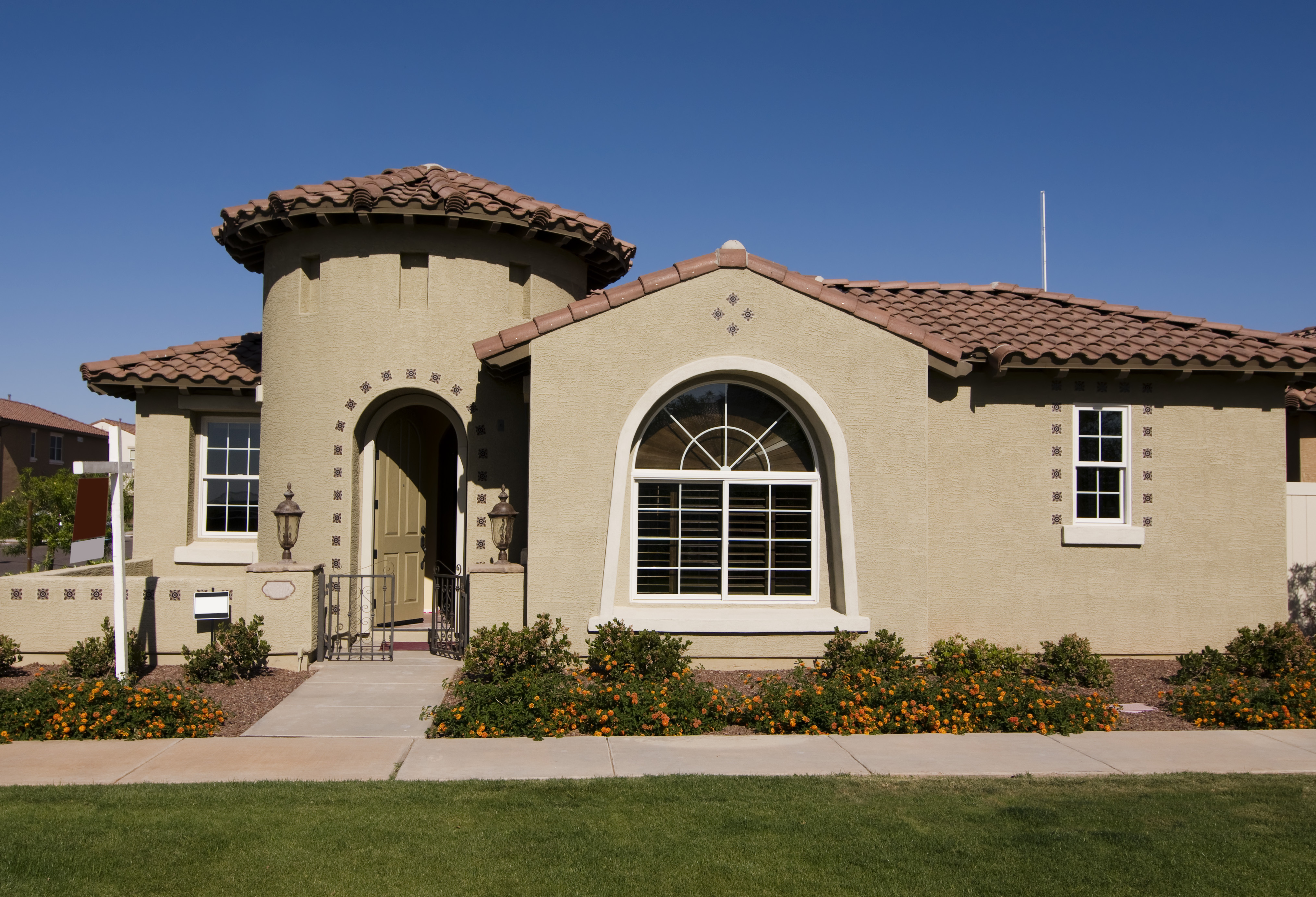 Exterior Brown Tan And Mediterranean Stucco Stone House