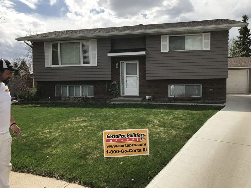 Exterior house painting by CertaPro house painters in Medicine Hat, AB