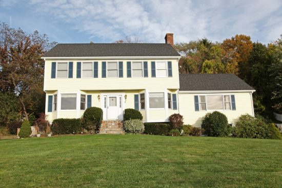 exterior house painters completed this colonial home repainting project.