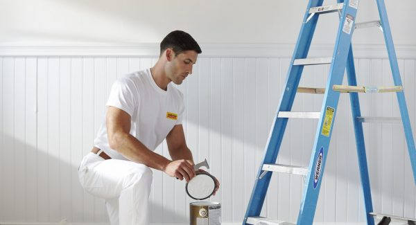 CertaPro painter prepares to tackle an interior house painting project.
