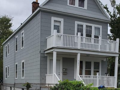 front and side of a house painted by certapro painters of wny