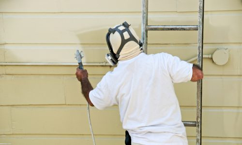 painting siding with spray paint