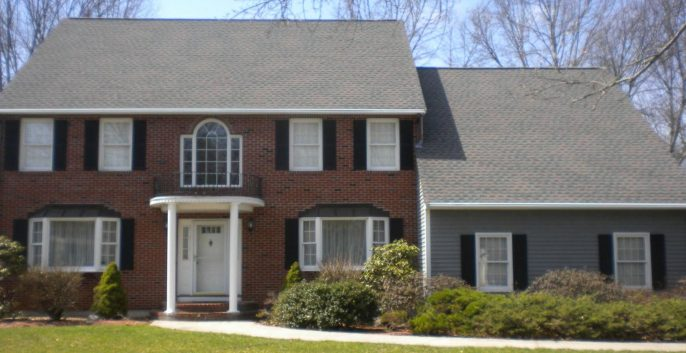 Exterior house painting by CertaPro painters in Bedford, MA