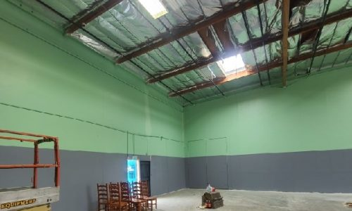 Green and Grey Accent Painted Warehouse Interior